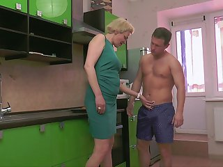 Mature short haired blonde MILF Madlen swallows every last drop