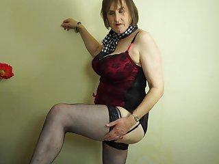Busty mature amateur British granny Allison masturbates in stockings