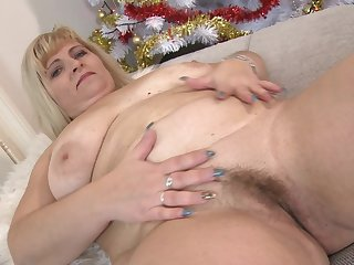 Chubby mature blonde amateur BBW Stefana E. stuffs her pussy with toys
