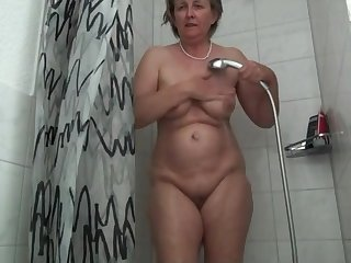 German grandma Frida enjoys the shower head