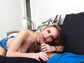 Young lady handles a big cock with her talented mouth
