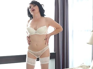 Kinky black haired MILF in white stockings Helen He teases her own pussy