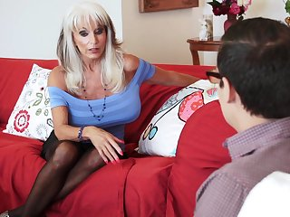Mature blonde whore Sally D'angelo blows and rides a big cock