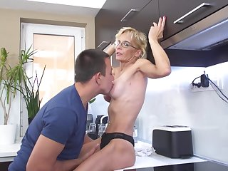 Mature blonde housewife Gizelda B. fucked doggy style in the kitchen