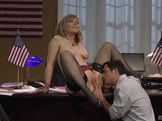 Mature blonde Nina Hartley bent over the desk and fucked in stockings